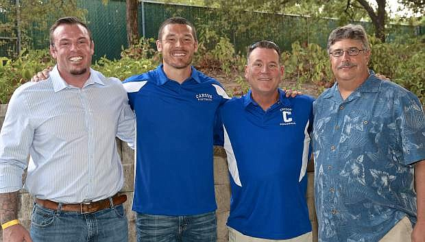 Carson High School Football Hall of Fame inductees pose for a photo Saturday night at the Marv Teixiera Pavillion. They are (L-R) Clint Treadway-Class of 1997, Scott Witter-Class of 2006, Coach Blair Roman and Matt Teixeira-Class of 1977.