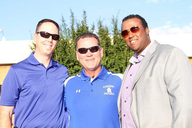 Two former Carson High Football players pose with Coach Blair Roman and were inducted into the Hall of Fame at the Kickoff and Hall of Fame Dinner Saturday. Class of 1999 graduate Dave Krueger (left) was an all-state running back and was also the Gatorade Player of the Year in Nevada. Class of 1998 graduate Justin Mitchell (right) was an all-state center his senior year.