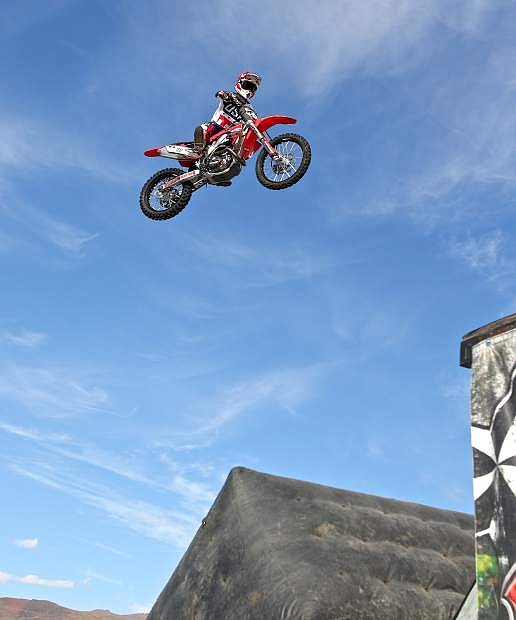 Stunt rider Jesse Jolson of Roseville perfoms a stunt on his Honda at Bikefest in Carson City Friday afternoon.