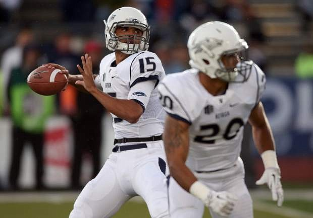 Nevada's Tyler Stewart (15) looks for an open player against Hawaii during the first half of an NCAA college football game in Reno, Nev., Saturday, Sept. 21, 2013. Stewart started the game due to Cody Fajardo being out with a knee injury. (AP Photo/Cathleen Allison)
