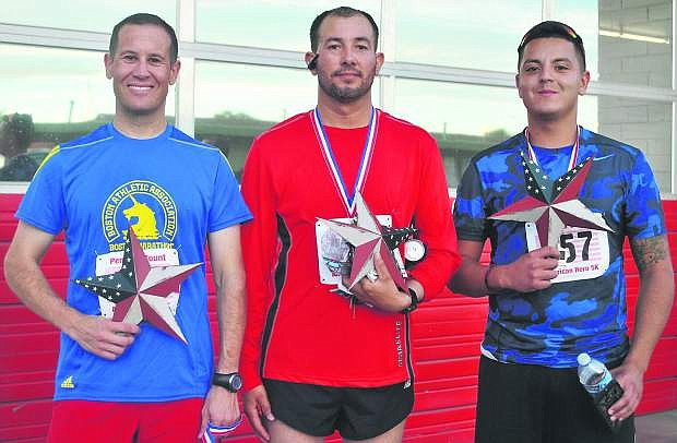 David Dees, left, stands with Gerardo Grifaldo and Alexander Alfaro as the first, second and third place winners of the race respectively.