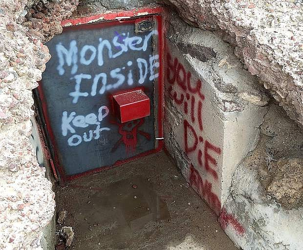 Vandals struck Hidden Cave east of Fallon recently leaving graffiti and bullet holes in a building. A $1,000 reward is being offerd for information about the person or persons responsible.