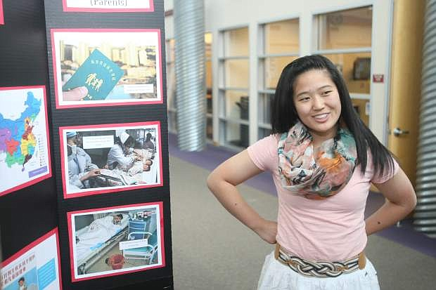Carson High School sophomore Lisarah Simonson, 16, talks about her project on Friday morning.