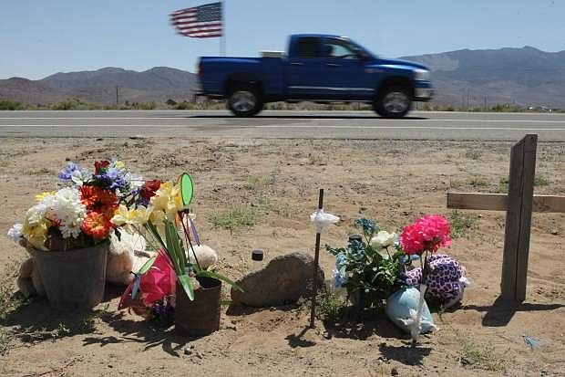 A roadside memorial on Highway 50 East near Six Mile Canyon Road.