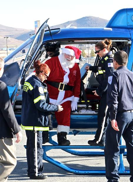 Santa Claus arrives at Walmart via CareFlight Wednesday morning for 'Holiday With A Hero' in Carson City.