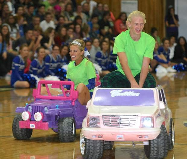 Homecoming court candidates Paris Regan and Connor Pradere make a grand entrance to the Homecoming assembly on Tuesday.