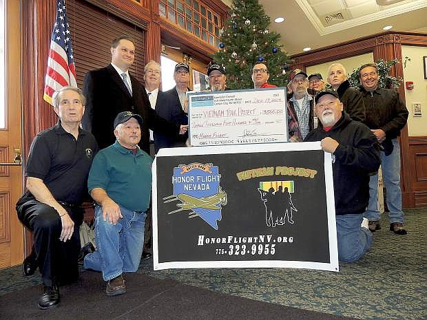 Members of the Kaempfer Crowell law frim gave Honor Flight Nevada a $3,500 donation on Friday. The money will be used to fly a Vietname veteran to Washingtion D.C.