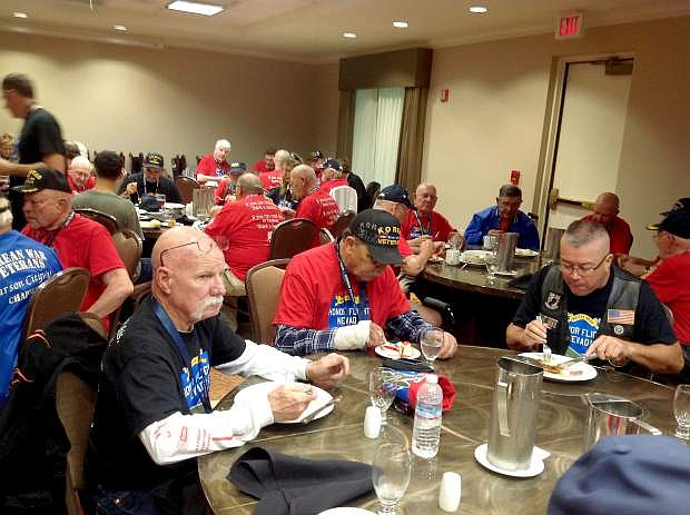 Carson City's Ken Beaton is currently on an honor flight with other veterans from Northern Nevada. He sent this photos from Friday at the group left from Reno and arrived in Baltimore Roy Evans of Carson City is picture on the left side of the table. All the males wearing red shirts are veterans, guests of Honor Flight Nevada. All the people in black shirts are volunteers serving the veterans.
