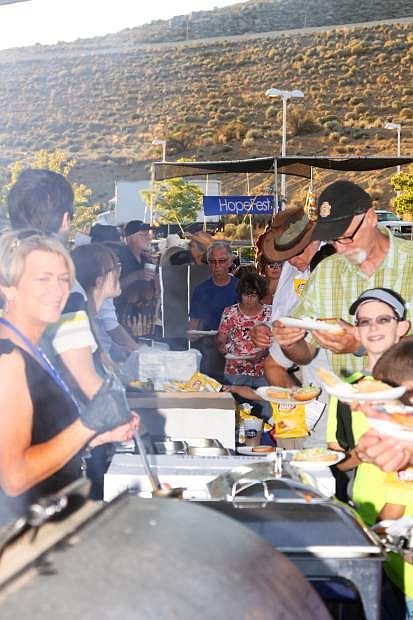 Hope Fest attendees enjoy a barbeque dinner Friday night.