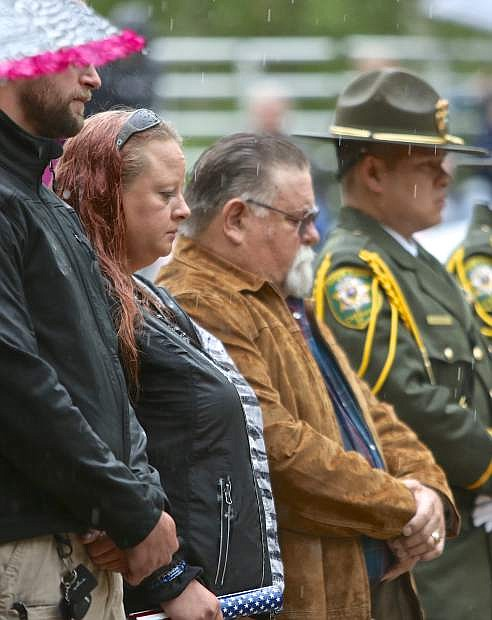 Deputy Howell's widow, Rachel, and her father-in-law, Kevin, stand during the Peace Officers memorial ceremony on the Capitol Mall.