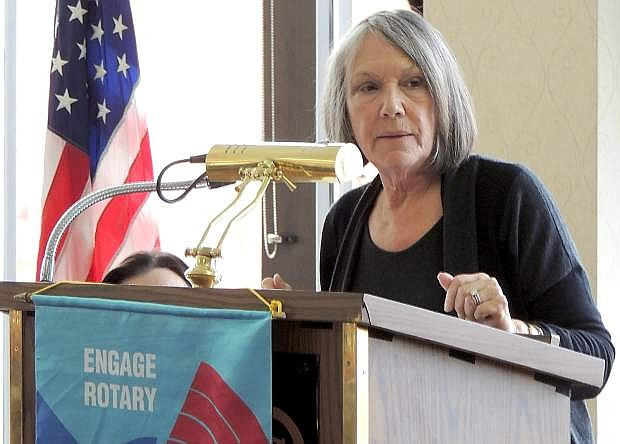 Collie Hutter, co-founder of Click Bond, talks to the Carson City Rotary Club on Tuesday.