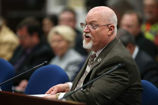 FILE - In this Wednesday, March 25, 2015 file photo, Nevada Assemblyman Randy Kirner, R-Reno, testifies on his proposal to dramatically change collective-bargaining rules for public employee unions in a hearing at the Legislative Building in Carson City, Nev. A money committee is reviewing a bill that would dramatically change the Nevada Public Employees' Retirement System.  The Assembly Ways and Means Committee held a meeting Wednesday, April 15, 2015 to discuss AB190, which raised many questions and concerns at a hearing in a separate committee last month.    (AP Photo/Cathleen Allison)