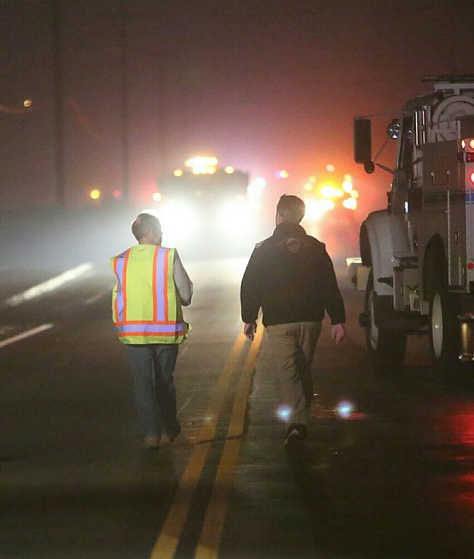 Carson City City Manager Nick Marano surveys the fire scene with Mayor Robert Crowell Thursday night.
