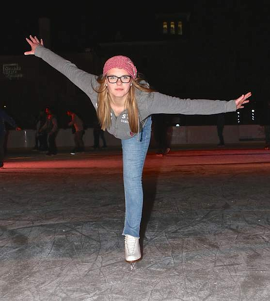 Carson High freshman Rylee Santos performs some skating tricks during lat month's Winterfest at the Arlington Square ice rink. Skating will end for the season today. Skate sessions are from 10 a.m. to 1 p.m. and 2-5 p.m. and 6-10 p.m.