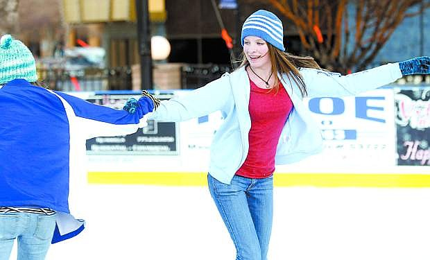 Cindy Juchtzer and Alex Drozdoff skate at the Arlington Square Ice Rink in 2011.
