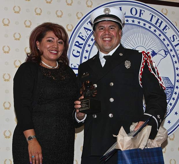 Ben Rupert (right) poses with his wife Sherry Saturday evening after receiving the 2014 Contributor/Supporter of the Year award at the American Indian Achievement Awards Banquet held at the Governor's Mansion in Carson City.