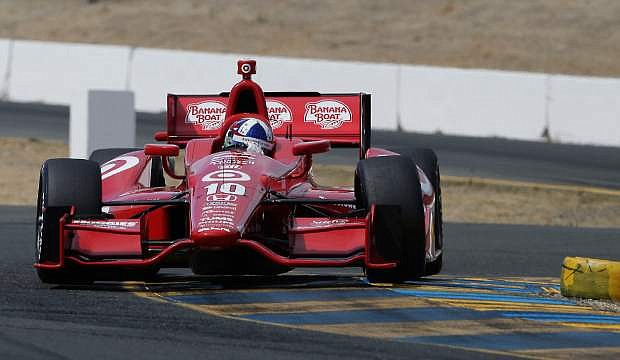 Dario Franchitti, of Scotland, takes a corner during qualifying for Sundays IndyCar auto race in Sonoma, Calif., Saturday, Aug. 24, 2013. Franchitti won the pole. (AP Photo/Rich Pedroncelli)