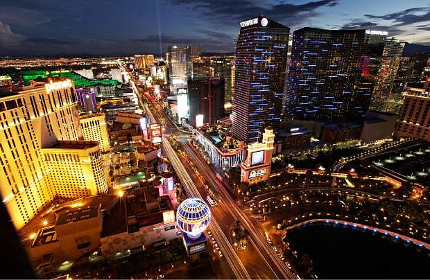 In this Sept. 16, 2014, photo taken with a slow shutter speed, the lights of cars blur along Las Vegas Boulevard in Las Vegas. Las Vegas doesn't exactly have a work commute problem but the four-mile Strip often gets clogged with tourist traffic. (AP Photo/John Locher)