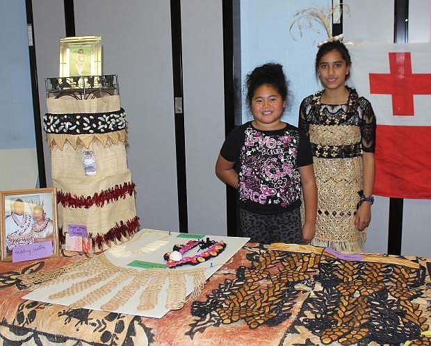 Items were laid out on a table of traditional dress from Tonga. Nola Otuafi, left, and Alsha Sharron were present to answer any questions attendees had on the country.