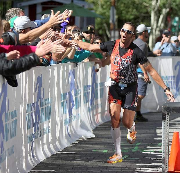 Australian Chris McDonald receives high-fives as he nears the finish line of the inaugural Ironman Lake Tahoe in 2013.