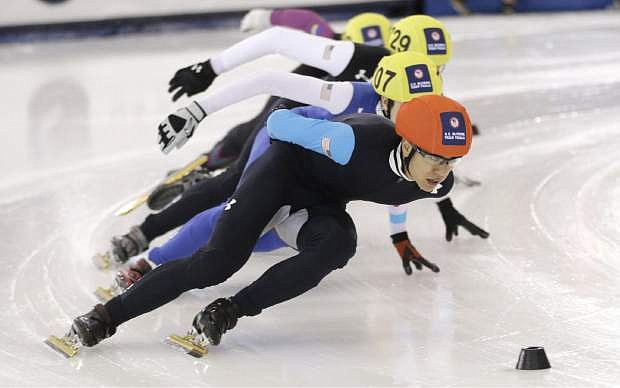 FILE - In this Jan. 5, 2014, file phot, J.R. Celski leads the pack as he competes in the men's 1,000-meter race at the U.S. Olympic short track speedskating trials in Kearns, Utah. The 23-year-old from Federal Way, Wash., will compete at his second Olympics, looking to add to the pair of bronze medals he won at the 2010 Vancouver Games. (AP Photo/Rick Bowmer, File)