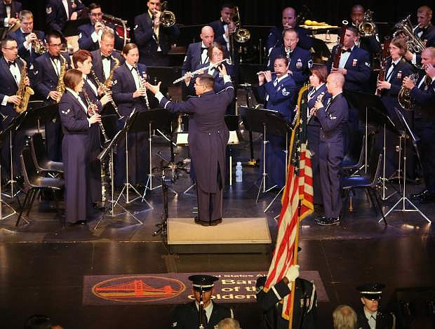 The U.S. Air Force of the Golden West Band performs the National Anthem to start their concert at the community center on Tuesday night.