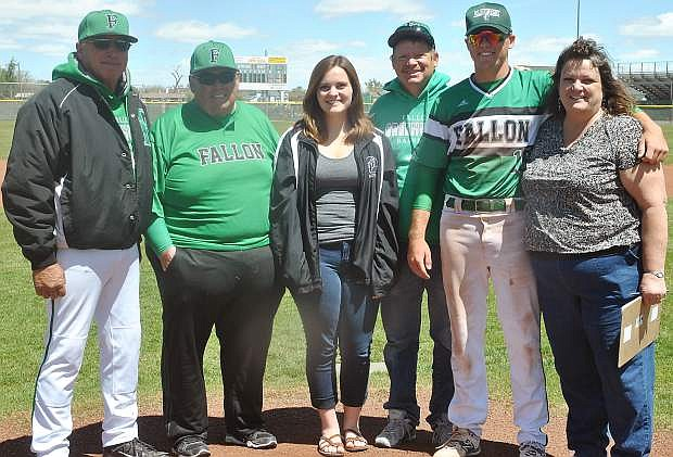 From left: Coach Lester de Braga, assistant coach Dave Munoz,  Kaitlyn Johnson (Kendall's sister), Boyd Johnson (Kendall's father) Kendall Johnson and Tina Johnson (Kendall's mother) stand for a photo on the Greenwave baseball diamond's mound.