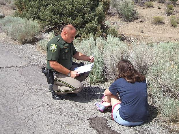 Carson City Sheriff's Office Deputy Apple speaks with a suspected intoxicated driver.