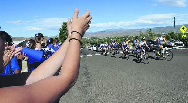 Carson High cheerleadersers welcome Pi Kappa Phi fraternity members who are cycling across the country to bring awareness about people with disabilities. The Ability Experience arrived at Western Nevada College Friday afternoon. There were many vendors on hand to give out information concerning aid to those with disabilities. Photo by Tim Dunn/Nevada Photo Source
