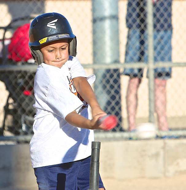 6-year-old Anthony Pacheco gets a hit for his Junior Giant 'Yellow Lightning' team Friday at the Livermore Sports Complex.