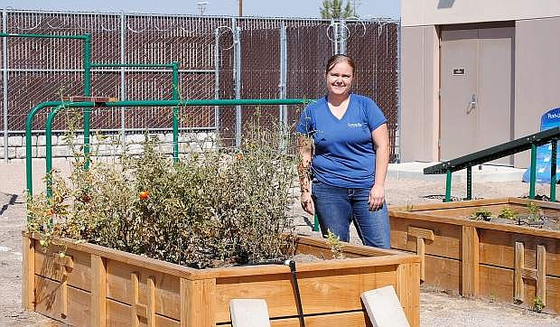 Jessica Stewart, senior detention specialist, shows off the garden that was added at the Churchill County Juvenile Justice Center earlier this spring.