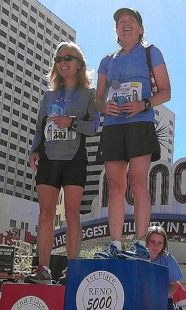 Fallon resident De Vere Karlson, right, stands atop the podium after she won her age group in Sunday's Reno Downtown River Run half marathon. She will compete Monday in the 118th Boston Marathon.