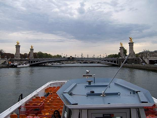 This is one of the 46 bridges over the Seine River in Paris taken tour boat. Hitler had ordered every bridge be blown and Paris be left a pile of rubble.