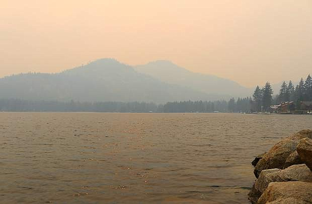 Heavy smoke filtered into the Truckee-Tahoe area Sunday evening, as seen here from the shores of Donner Lake in western Truckee.