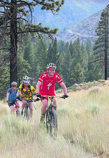 Bikers ride the Ash Canyon trails above Carson City on June 30. The 7-mile trail connecting Ash and Kings canyons in the hills east of Carson City will officially open this weekend with a ribbon-cutting ceremony on Saturday.