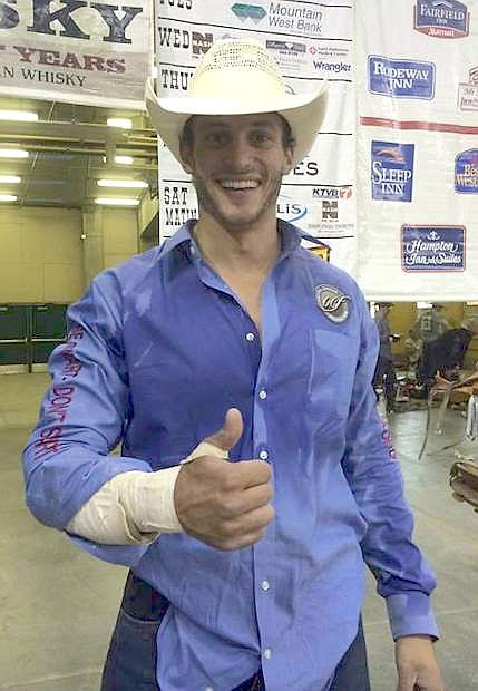 Cody Kiser, 23, gives a thumbs-up after competing Thursday at the Snake River Stampede.
