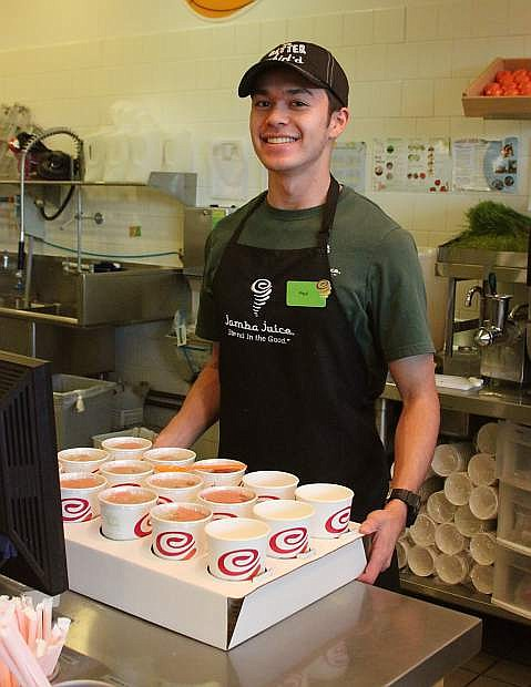 Paul Klemm, treasurer of the New Entrepreneur Network club at Carson High School, is in training to become a manager at Jamba Juice.