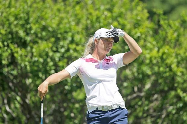 Suzann Petterson of Norway watchers her tee shot on the second hole during the third round of the North Texas LPGA Shootout golf tournament at the Las Colinas Country Club in Irving, Texas, Saturday, May 3, 2014. (AP Photo/LM Otero)