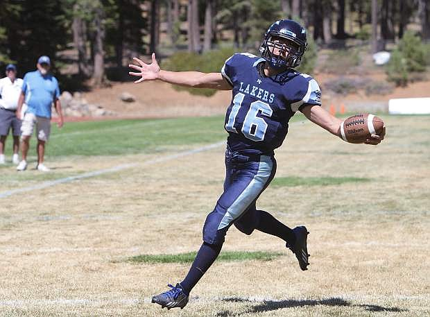 Brandon Hayakawa, seen scoring a touchdown for the Lakers last year, was allowed to transfer to Truckee for his senior season after learning that North Tahoe was forced to cancel its 2014 campaign due to a lack of players.