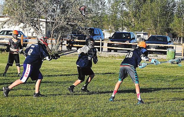 Oasis lacrosse player Josh Carter flingsa shot on goal during the Bighorns' practice on Tuesday at the Churchill County Regional Park. Oasis plays in Saturday and Sunday's under-15 state tournament at Spanish Springs High School.