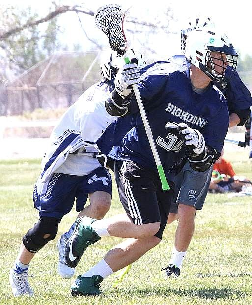 Oasis Bighorns lacrosse player Trent Thorn avoids a defender this season. The Bighorns won both games last week to remain unbeaten this year.