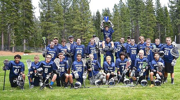 The Oasis Bighorns under-15 boys lacrosse team celebrates its High Sierra League championship Saturday in Tahoe City.