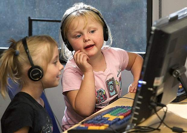 Alexa Manies and Kelli Ann Plautz, both 5, play in the youth area of the Carson City Library in this file photo from Oct. 23, 2014. The Carson City Leadership Class of 2015 is hosting a fundraiser at Applebee's 5-8 p.m. Feb. 25. Applebee's will donate 15 percent of the night's proceeds to improve the children's area at the library, patrons must present the flier.