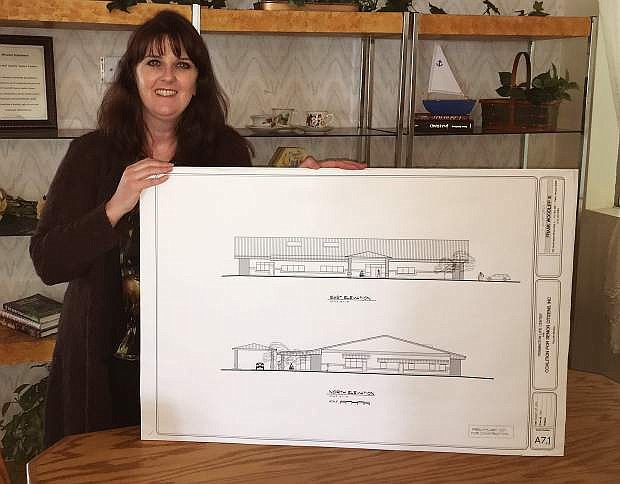 Jamie Lee's last day  as director of the Churchill County Senior Center was Friday. She is showing the plans for the new senior center.