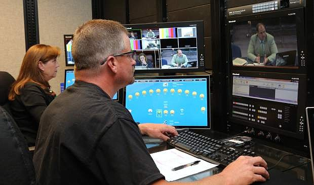 Don Glaze, technical communications systems specialist, and Becky Wood, control room supervisor, operate live-stream video cameras on Monday in the newly upgraded broadcast and production studio located in the Legislature building.