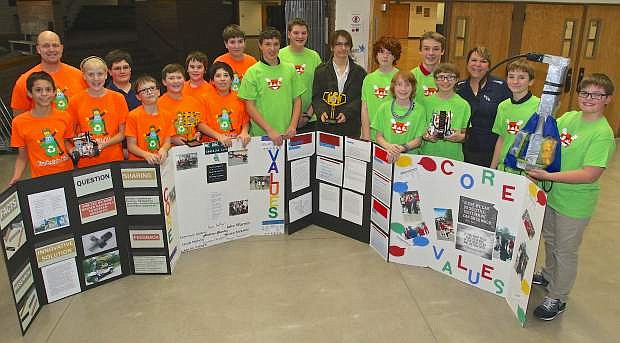 Eagle Valley Middle School Lego League Champions pose for a photo Thursday. They are, in no particular order: Brandon Thompson, Devon DeFilippi, Bryar Fancher, Emmanuel Alvarez, Andrius Stankus, Carlos Torres, Jake Warren, Jake Nichols, Nevan McIlwee, Gino Goggiano, Ryan Cooley, Daniel Lewis, Kai Miller, Cash Farnworth, Geoffrey Roullard, Caedron Douglas, Tyler Williams, Liam Kordonowy and coaches Lisa Stocke-Koop and Eric Fancher.