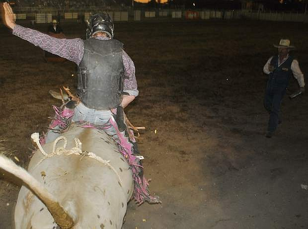 Levi Quillan's bull is let loose while he competes for points in mens bull riding.