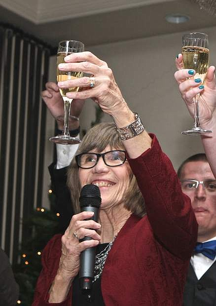 Carson City Library Trustee Chair Sandy Foley toasts Black & White Ball partygoers and the new year Wednesday night in Carson City.