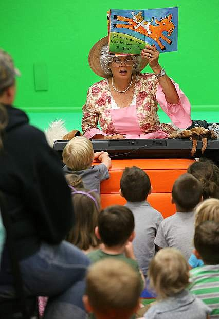 Maureen Conlin performs her Rhythm and Rhyme with Mother Goose show during Story Time at the Carson City Library on Thursday. More than 75 people attended the event, which was funded through a Nevada Arts Council grant.