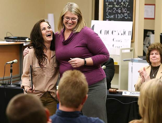 Kayla Homme, left, hugs Carson City Library Director Sena Loyd after receiving her Manufacturing Technician Level 1 certificate during a brief ceremony at the library in Carson City, Nev., on Thursday, Oct. 22, 2015. Homme is one of the first three graduates from the library's accelerated program.